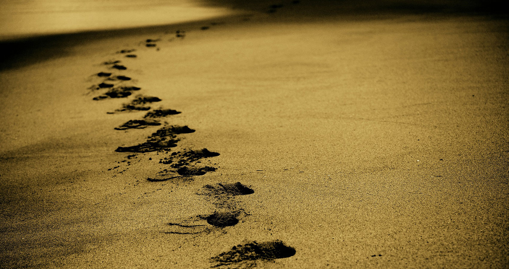 Footprints, a poem written by Shade at Spillwords.com