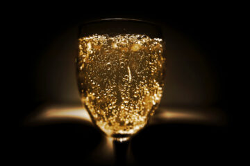 Hold Your Glass Up, written by Courtney Trowman aka CC Bella at Spillwords.com