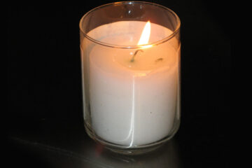 Watching Candles Burn, a poem written by Mark Tulin at Spillwords.com