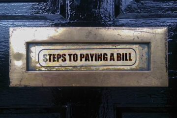 Steps To Paying A Bill, poetry written by Joan McNerney at Spillwords.com