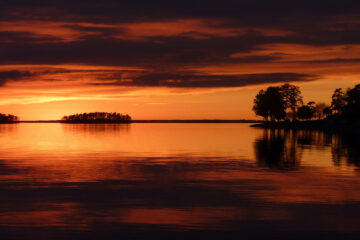 Calm Waters Of Time Below An Orangey Sky, poetry by Linda Imbler at Spillwords.com