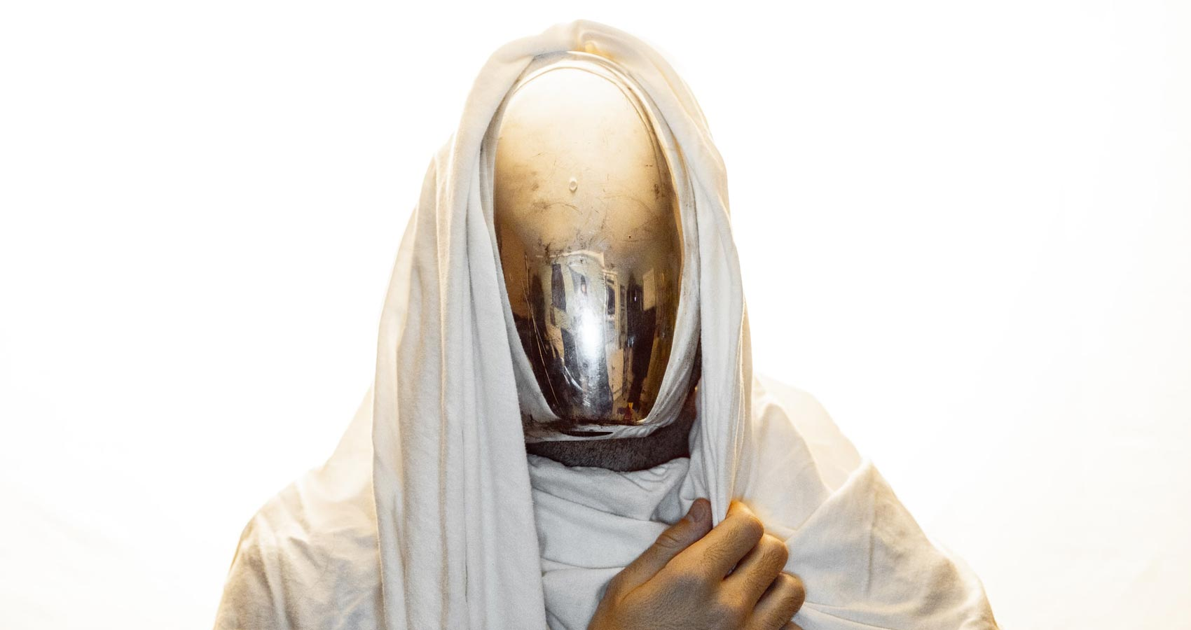 Masked, micropoetry by Salam Adejoke at Spillwords.com