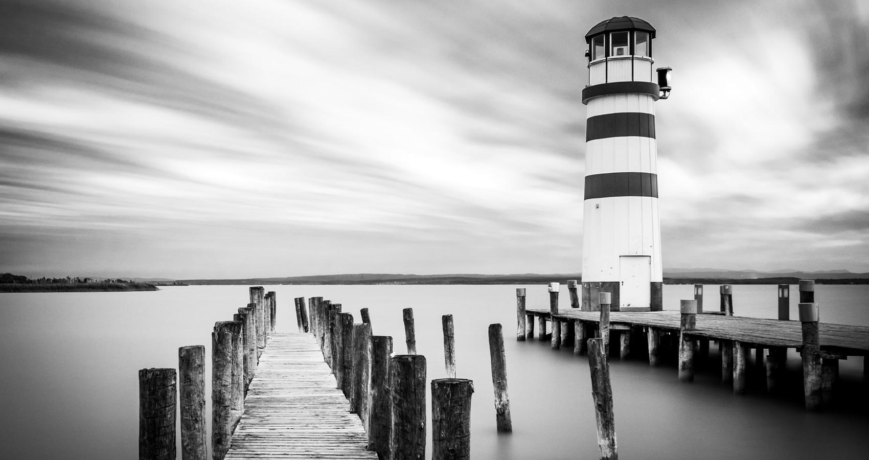 An Old Lighthouse Next to a Lonely Pier and a Cup of Coffee, flash fiction by Marcelo Medone at Spillwords.com